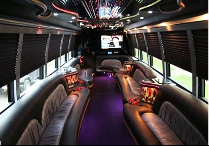 NEW LUXURY PARTY BUS Description Ostrich Leather Seating Bar Table Pole Changing 5 Colors 6 Flat Screen TVs Including A 52 In TV High End